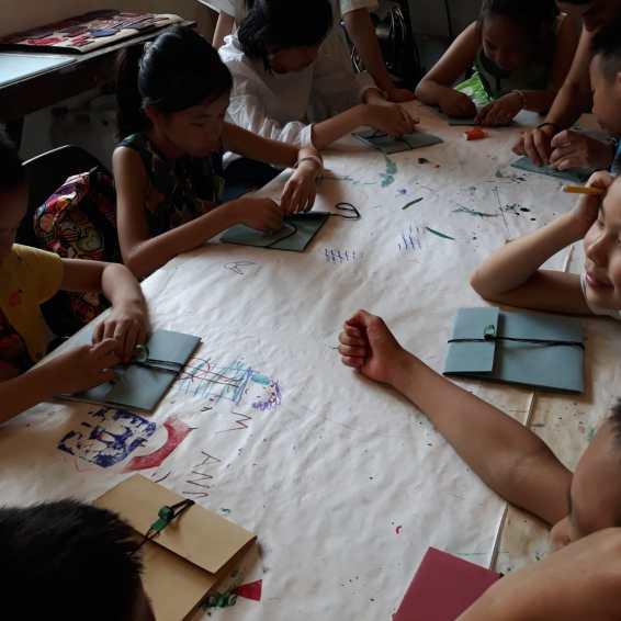 Laboratorio di stampa con bambini cinesi, Forte Marghera